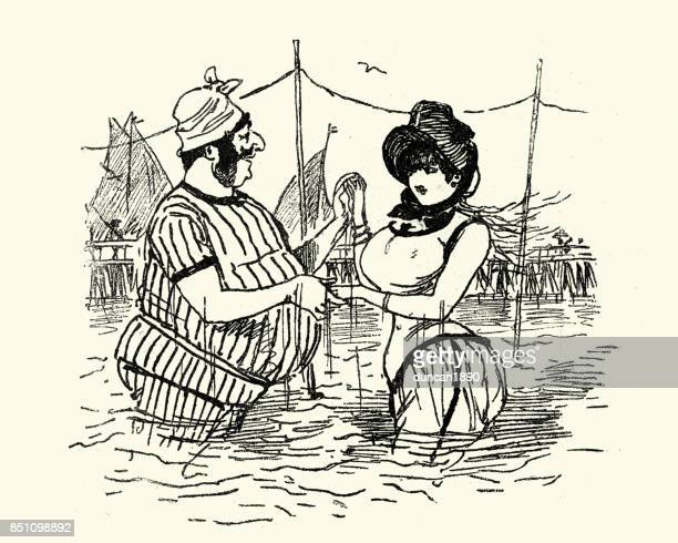 Victorian man and woman paddling in the sea
