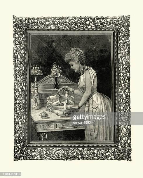 ilustraciones, imágenes clip art, dibujos animados e iconos de stock de mujer victoriana usando un lavabo, 1890, siglo xix - palangana