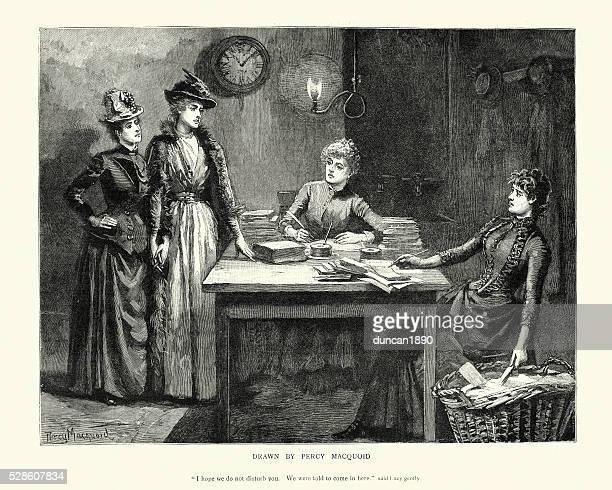 Victorian women writing at a desk