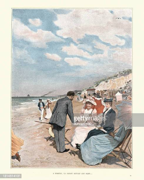 victorian's holidaying on the beach, etretat, normandy, france, 19th century - normandy stock illustrations