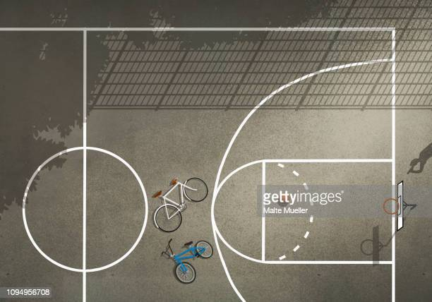 view from above bicycles and basketball on basketball court - incidental people stock illustrations