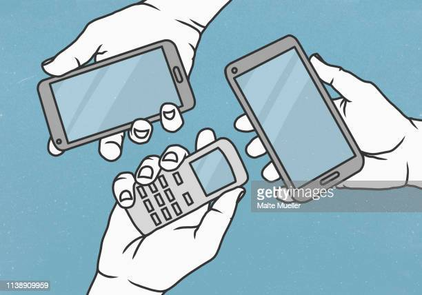 view from above hands holding cell phone and smart phones - social media stock illustrations