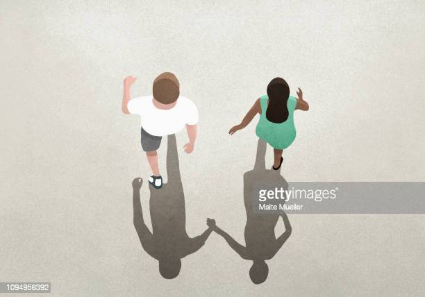 ilustraciones, imágenes clip art, dibujos animados e iconos de stock de view from above shadow of couple holding hands - cariñoso