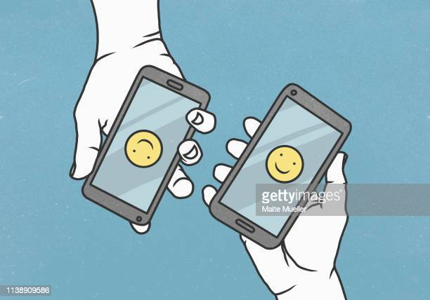 ilustrações, clipart, desenhos animados e ícones de view from above smiley faces on smart phones - flirting