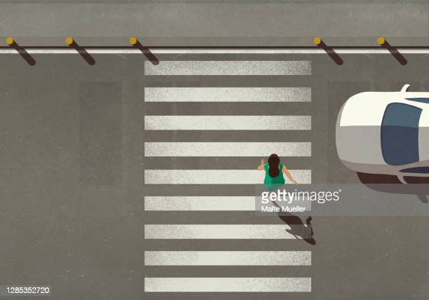 view from above woman crossing city street at crosswalk - road marking stock illustrations