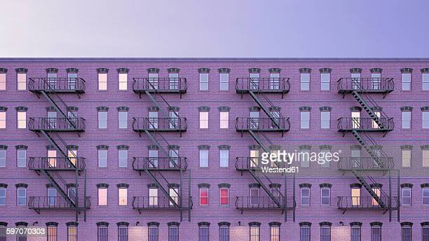 view to multi-family house with fire escape staircases at blue hour, 3d rendering - facade stock illustrations
