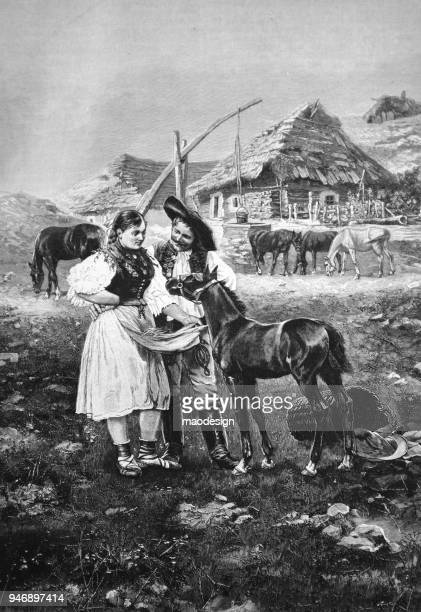 Village scene with a pair of young farmers feeding their foal _ 1895