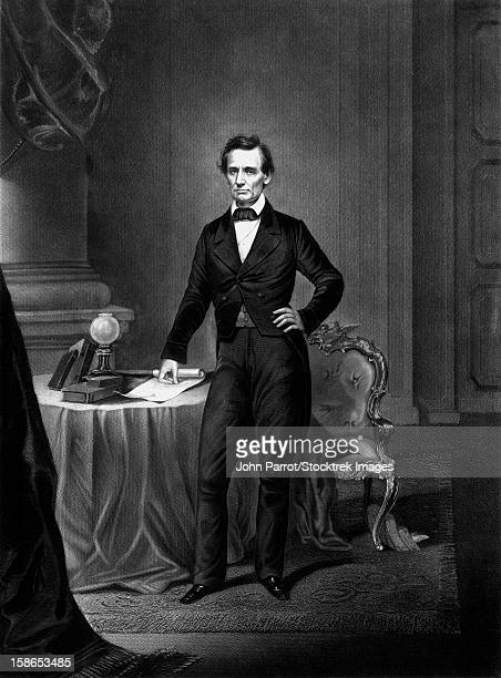 Vintage Civil War era print of President Abraham Lincoln standing near a table.