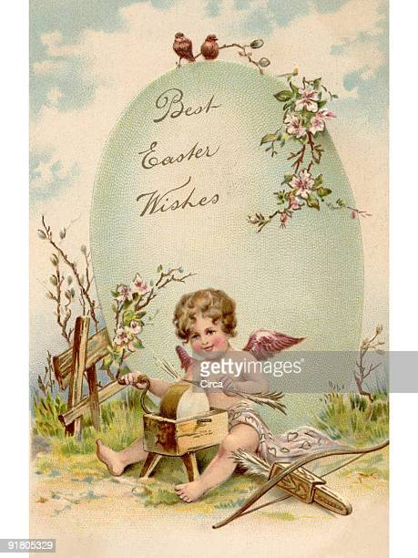 A vintage Easter postcard of a cupid making arrows and a large Easter egg