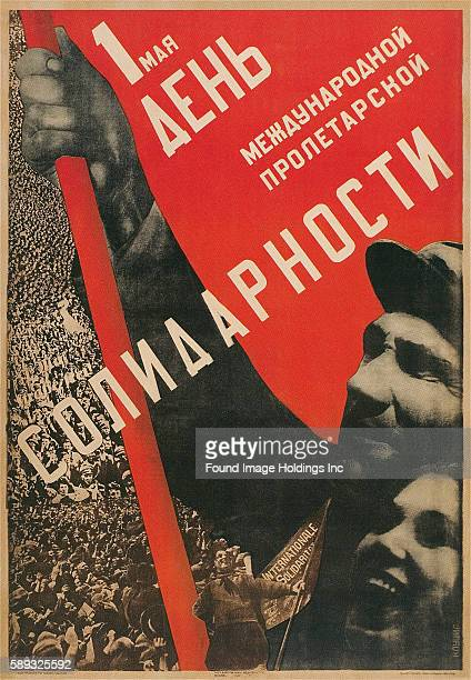 Vintage illustration of a Soviet International Proletariat Solidarity Poster featuring two Soviet people waving a flag in front of a massive...