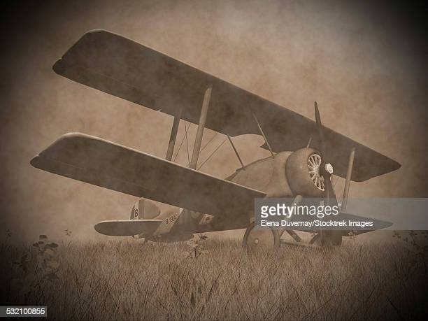 vintage image of a military biplane parked on the grass. - biplane stock illustrations, clip art, cartoons, & icons