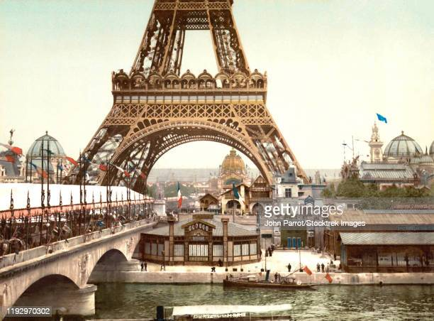 vintage photochrom image of the eiffel tower during the exposition universelle, 1900. - 1900 1909 stock illustrations