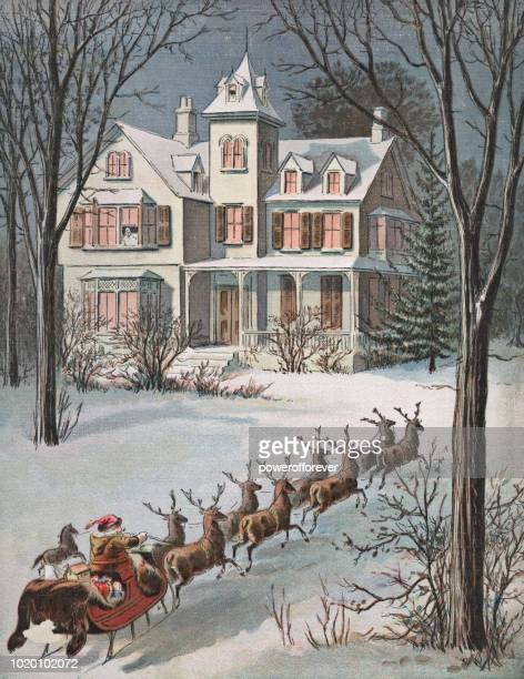 vintage santa claus and reindeer at a house on christmas - archival stock illustrations