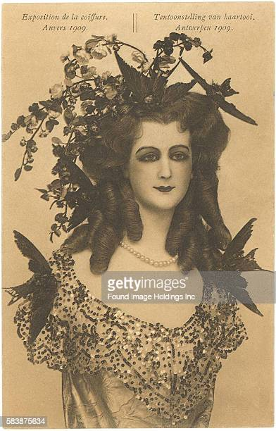 Vintage sepiatoned poster illustration for a Belgian coiffure exposition in Antwerp in 1909 showing a woman with an elaborate ringlet hairstyle that...