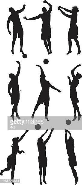 volleyball players in action - sports equipment stock illustrations