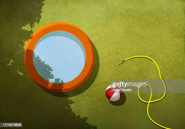 wading pool, beach ball and hose in sunny backyard - silence stock illustrations