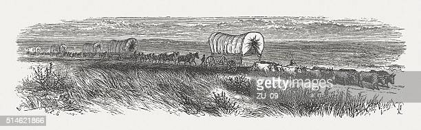 wagon train of american settlers, wood engraving, published in 1880 - prairie stock illustrations, clip art, cartoons, & icons