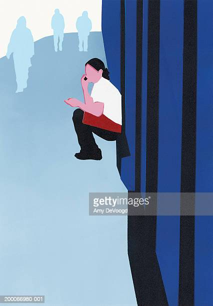 Waitress crouched outside on street talking on mobile phone