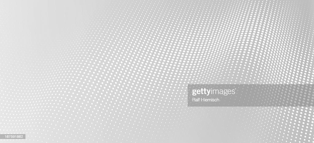 A wave pattern of white dots on a gray background : stock illustration