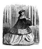 well dressed woman walks past fashion