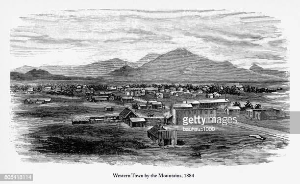 western town by the mountains, early american engraving, 1884 - prairie stock illustrations, clip art, cartoons, & icons