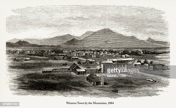 western town by the mountains, early american engraving, 1884 - paddock stock illustrations, clip art, cartoons, & icons