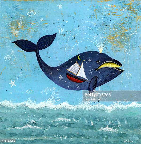 A whale with a sailboat inside of it