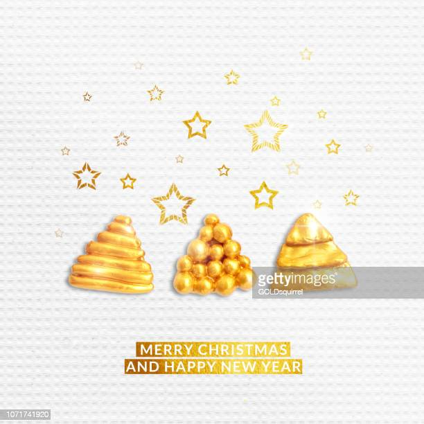 White textured seamless paper background with luxury abstract handmade Christmas Trees painted on gold and stars shapes and text MERRY CHRISTMAS AND HAPPY NEW YEAR