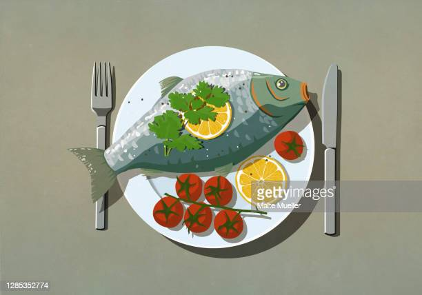 whole fish and tomatoes on dinner plate - illustration stock illustrations