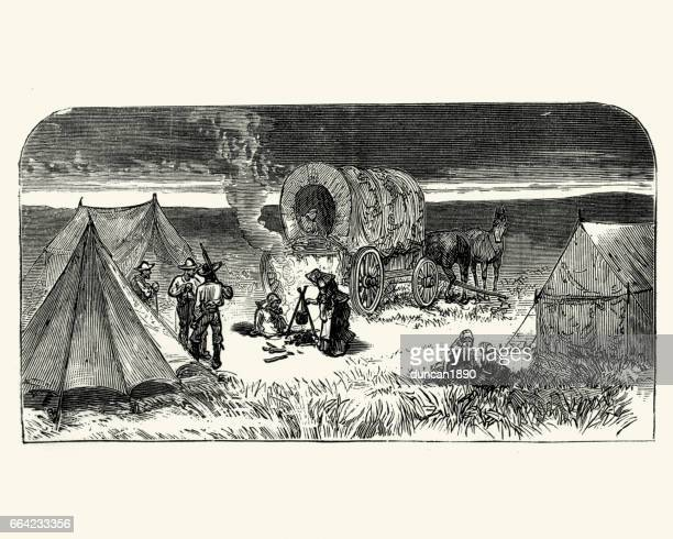 wild west cowboy pioneer camp and wagon - horse cart stock illustrations, clip art, cartoons, & icons