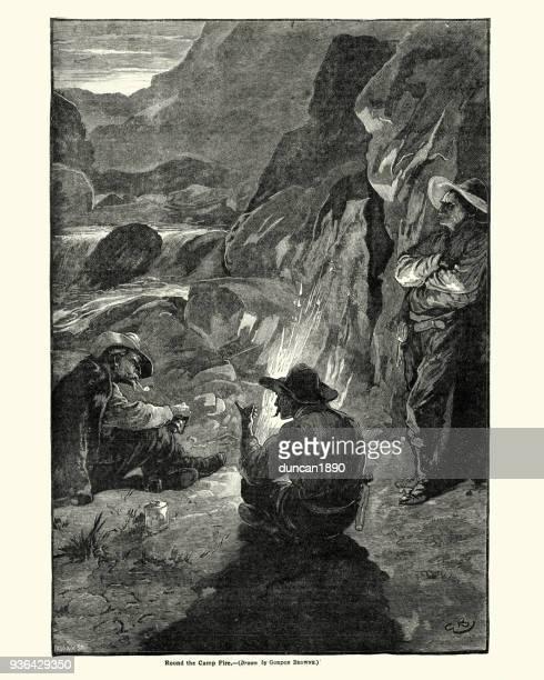 Wild west cowboys sat round a campfire, 19th Century