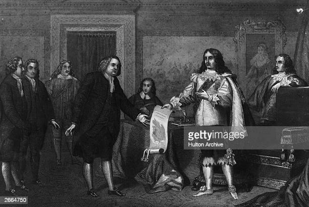 William Penn , English Quaker and the founder of Pennsylvania, receives the Charter of Pennsylvania from King Charles II in payment of a debt owed to...
