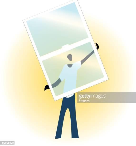 A window installer holding a glass pane