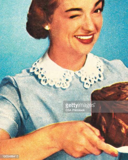 winking woman holding chocolate cake - dessert stock illustrations
