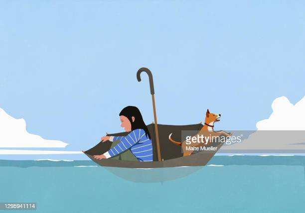woman and dog in umbrella floating on sea - safety stock illustrations