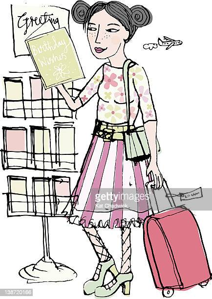 A woman at the airport buying a greeting card
