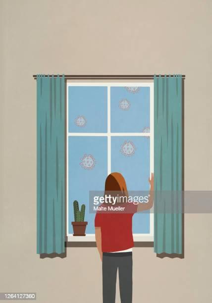 illustrations, cliparts, dessins animés et icônes de woman at window watching floating coronavirus particles - confinement clip art