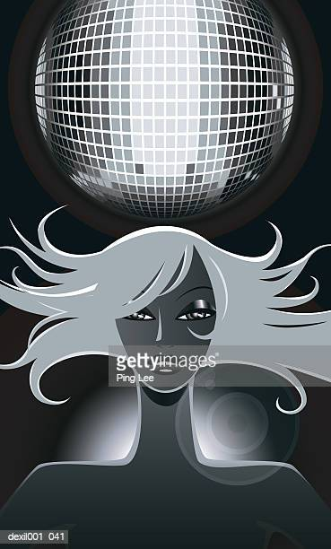 Woman below discotheque crystal ball