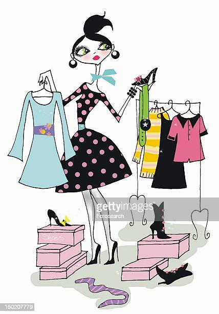 Woman choosing clothes and shoes