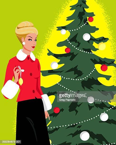 woman decorating christmas tree - updo点のイラスト素材/クリップアート素材/マンガ素材/アイコン素材