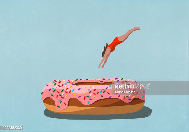 woman diving into large sprinkled donut - temptation stock illustrations