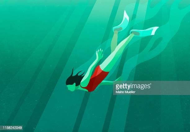 woman diving underwater in ocean - erforschung stock-grafiken, -clipart, -cartoons und -symbole