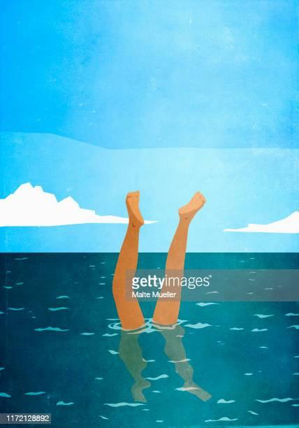 woman doing handstand underwater in ocean - wildlife stock illustrations
