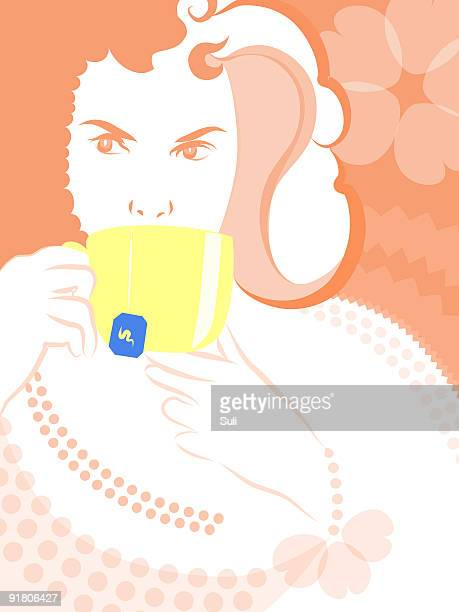 A woman drinking from a cup of tea