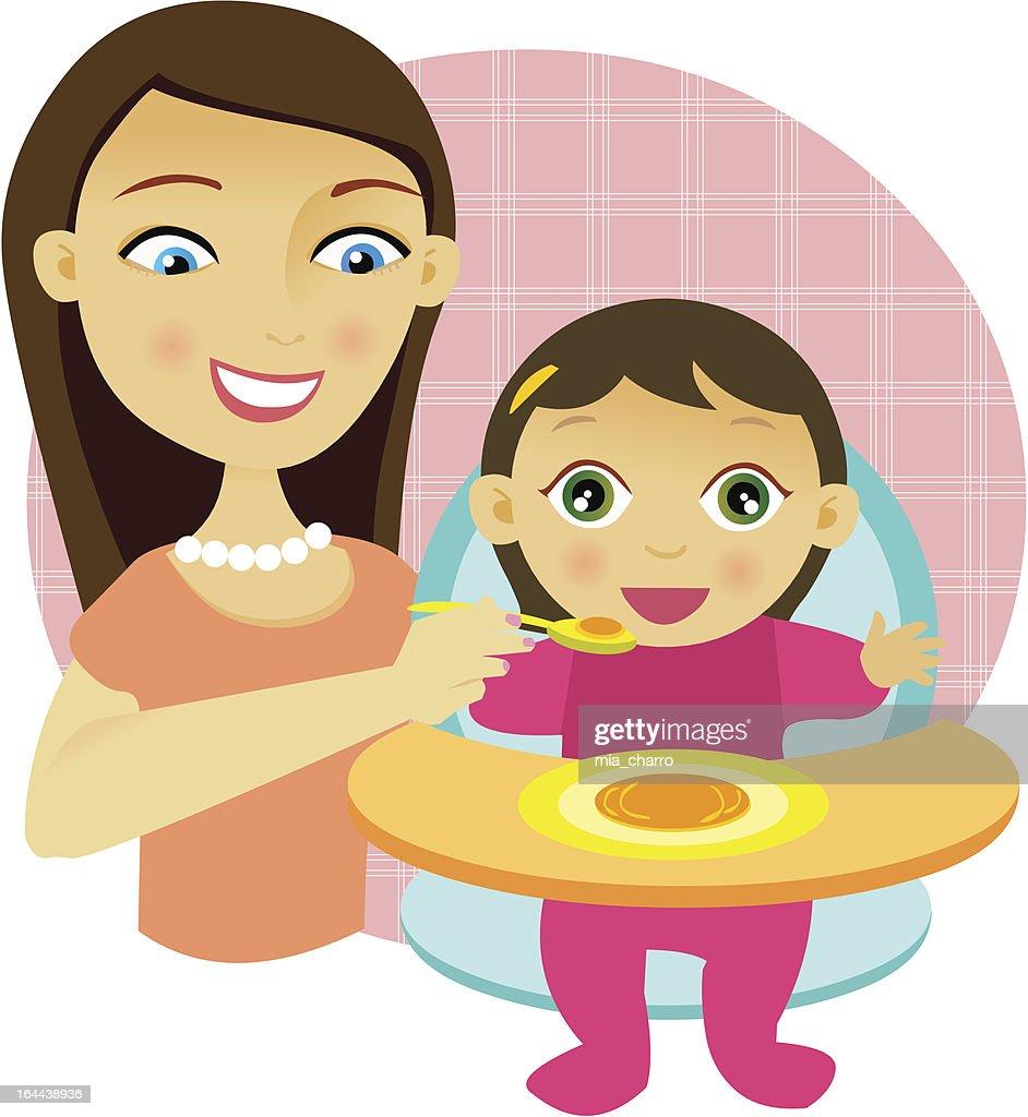 Woman feeding a baby