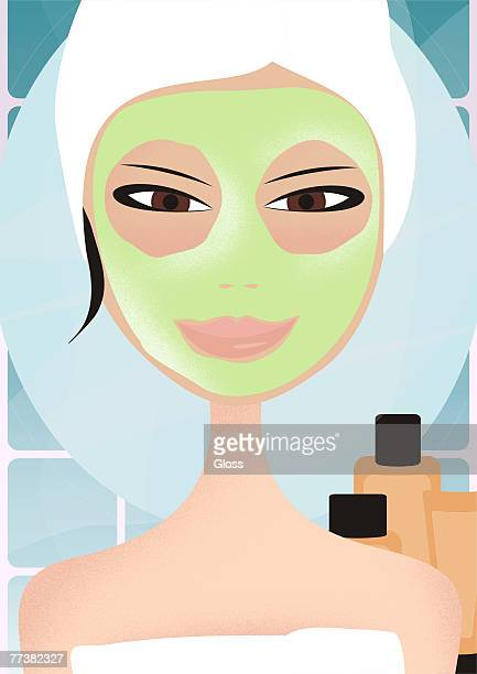 A woman getting a facial at the spa