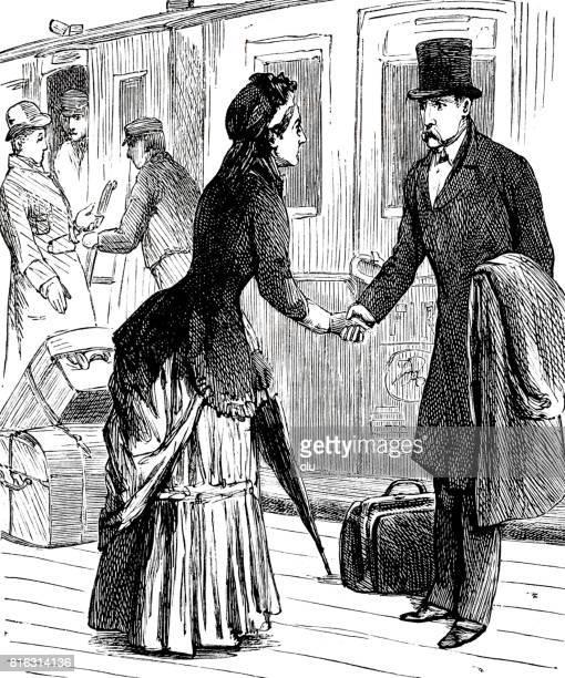 Woman giving handshake to a man on the train platform