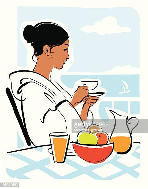 Woman having breakfast on deck