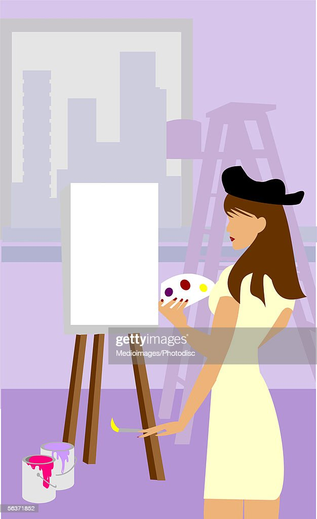 Woman Holding A Paint Brush Standing In Front Of An Easel Stock