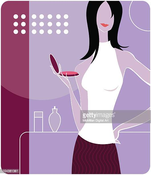 Woman holding makeup compact